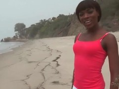 Black chick on the beach in skintight yoga pants